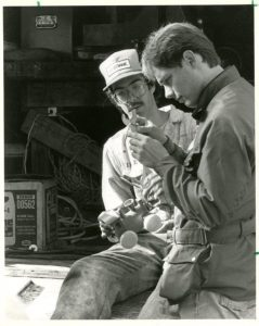 "Two students work on a portion of the 1984 float ""A Knight To Remember."""