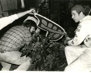 "Two students work on the butterfly on the 1965 float ""Good News Travels Fast."""