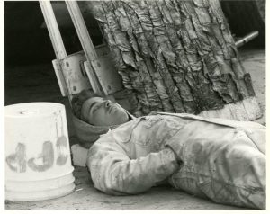 """A student takes a nap from working on the 1984 float """"A Knight To Remember."""""""
