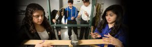 A group of students work together as a team in the Engineering Lab