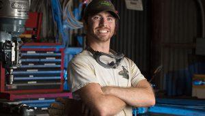 Elijah Koerner standing in workshop