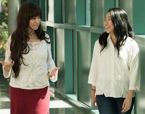 Marwa Mhtar and Su Yeon Kim walking down hallway
