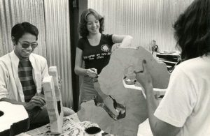 Students decorate the lettering on a float in the 1970's.
