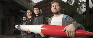 Richard Picard, Ethan Sichler, Will Morris and Edwin Betady with their test rocket
