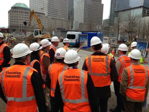 Hardhat workers discussing superstorm Sandy