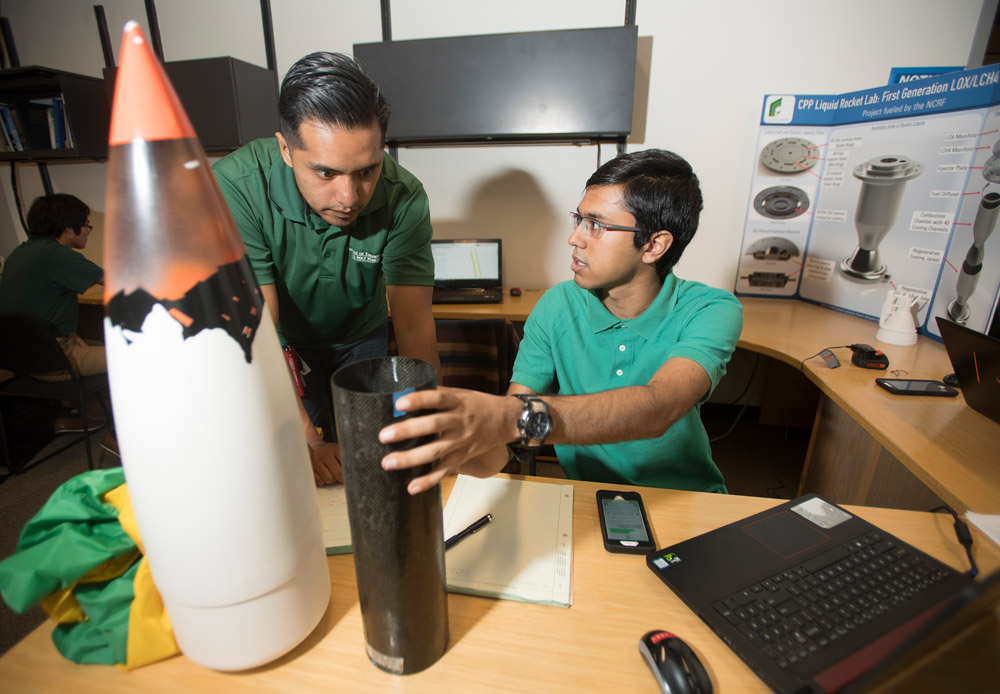 Jairo Sanchez and Vishal Barkataki at work at the Liquid Rocket Lab.