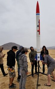 Students prepare a Patriot missile rocket for test launch.