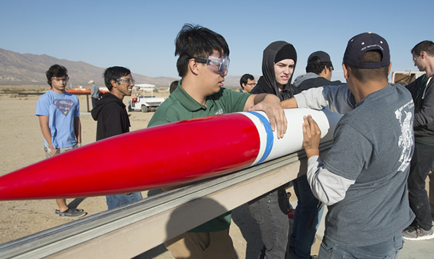 Rocketry students preparing rocket