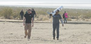 Rocketry students in desert