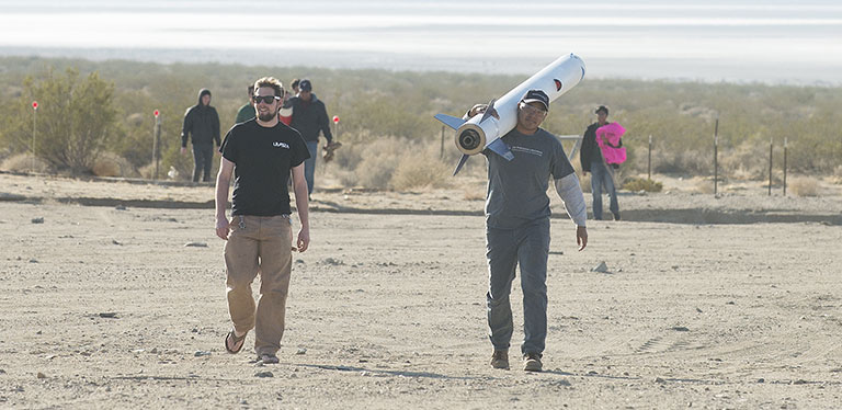 Rocketry students in desert
