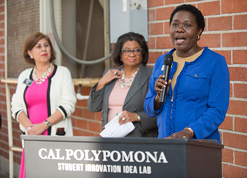 Professor Olukemi Sawyerr speaks at the grand opening of Innovation Orchard at Ganesha High School, part of the Student Innovation Idea Lab for Cal Poly Pomona.