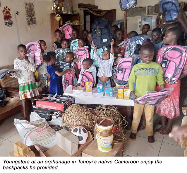 Youngsters at an orphanage in Tchoyi's native Cameroon enjoy the backpacks he provided.