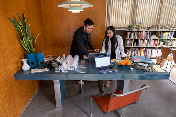 Noam Saragosti and Juhee Park work from the Neutra VDL House in Los Angeles