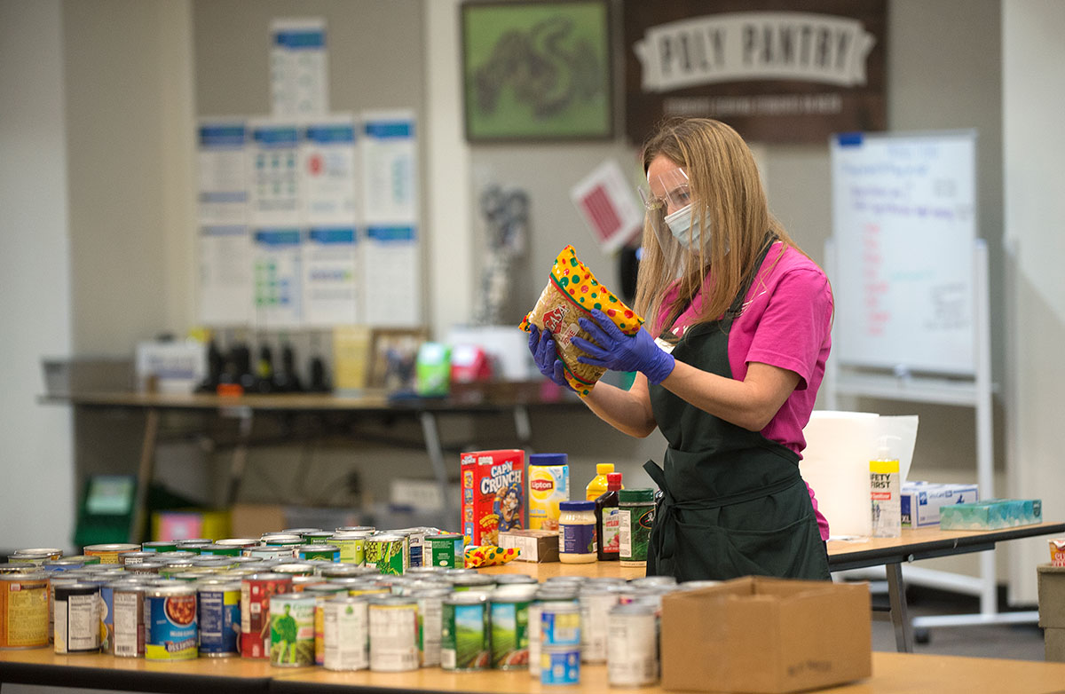 A staff member checking on items in the Poly Pantry